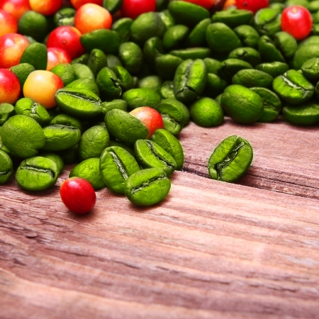 Green coffee beans on wooden background. photo