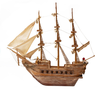 Antique ship as wooden model on white background. photo