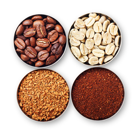 instant coffee: Bowls with green, roasted coffee beans, ground and instant coffee isolated on white.
