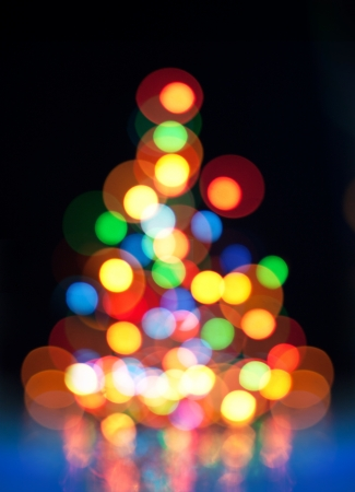 Abstract bokeh Christmas tree, magic colorful blurred background. photo