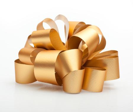 Gold ribbon bow on white background.