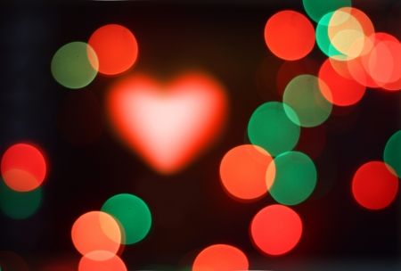 Abstract bokeh, magic colorful blurred background with heart. photo