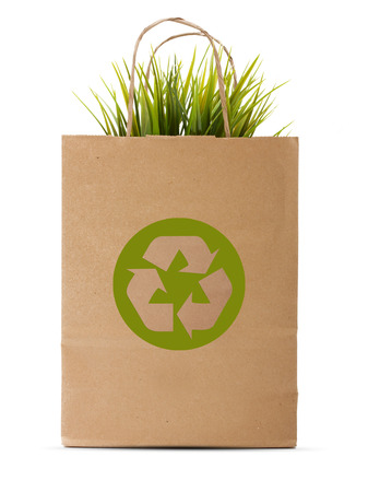 recycling sign: Paper shopping eco bag with green grass isolated over white background.
