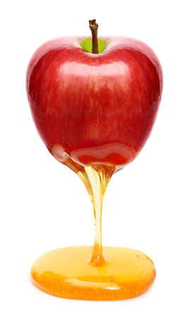 Red apple with honey isolated Stock Photo