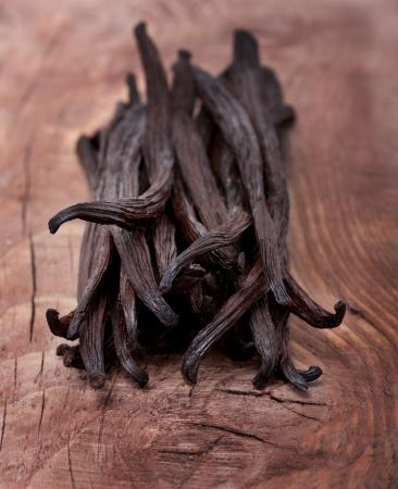 Vanilla pods on wooden background