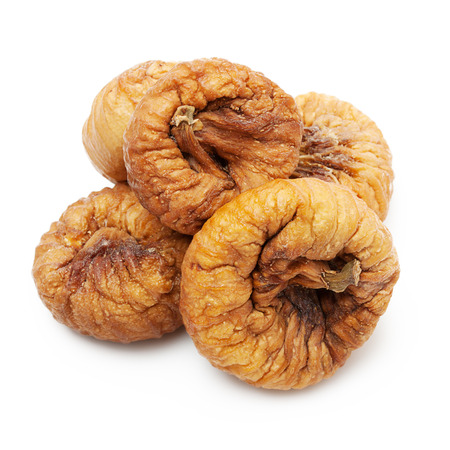 Dried fruit figs heap isolated on white background