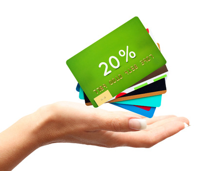 Woman hand with credit, discount cards isolated on white background.
