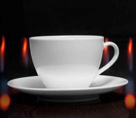 Coffee cup with smoke and abstract bokeh photo