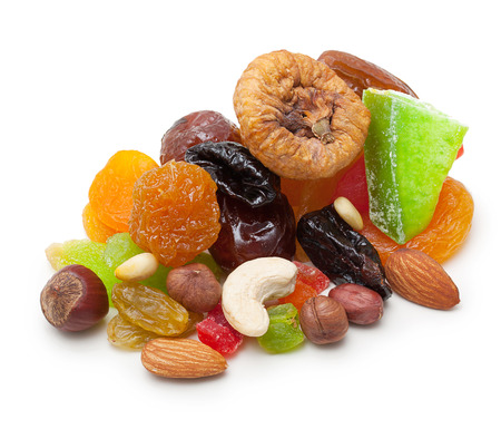 Mix dried fruits and nuts isolated on white background photo
