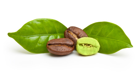 Green and black coffee beans on white background. Stock Photo