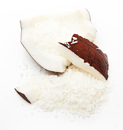 Coconut chips on white background. photo