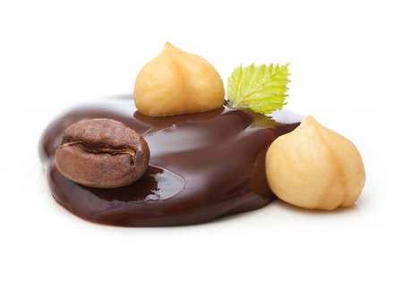 liquid chocolate: Chocolate drop with nuts and coffee grain on a white background Stock Photo