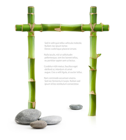 thalasso: Bamboo border made of stems and stones isolated on white background. Stock Photo