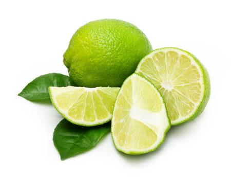 lime green background: Green lime with leaf isolated on white background. Stock Photo