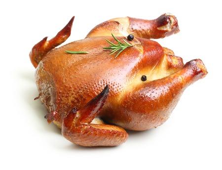 pollos asados: Pollo asado aislado en fondo blanco.