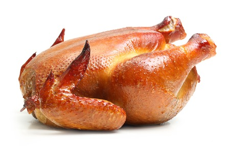 Roast chicken isolated on white background. Фото со стока