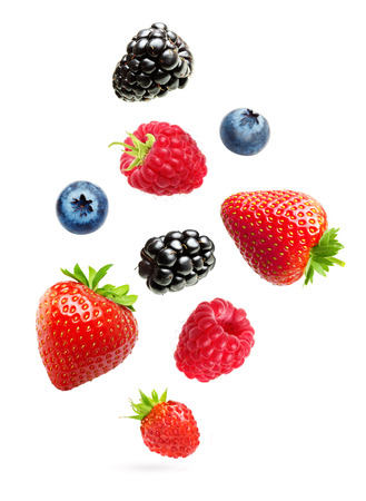 fruit drop: Falling berries isolated on white background Stock Photo
