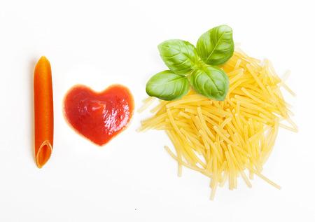 hape: Pasta and basil leaf on white background