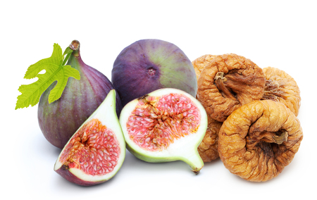 Fresh and dried fruit figs heap isolated on white background