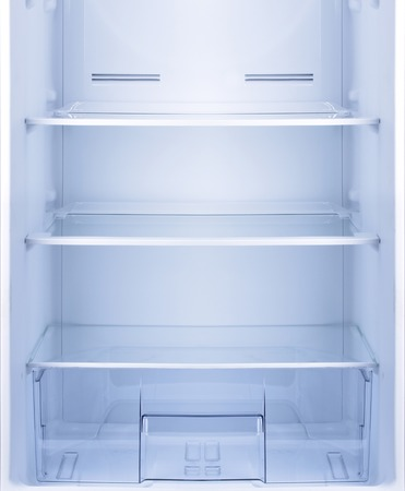 refrigerator: Empty open fridge with shelves, refrigerator. Stock Photo