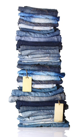 slacks: Pile of blue jeans with tags isolated on white.