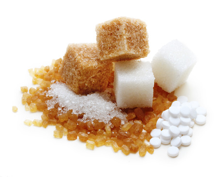 white cane: Brown and white cane sugar cubes n white background.
