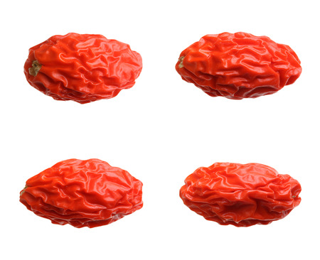 herbology: Dried goji berry isolated on white background.
