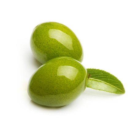 Green olives with leaves isolated on white Stock Photo