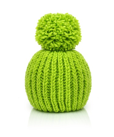 Green wool knitted hat isolated on white background.