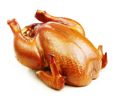 Roast chicken isolated on white background. Stock Photo