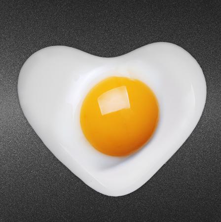 sunnyside: Fried egg like heart on frying pan