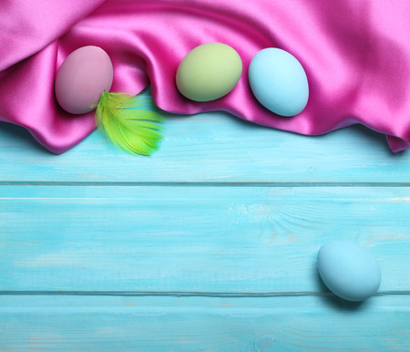 Easter colorful eggs on blue wooden background