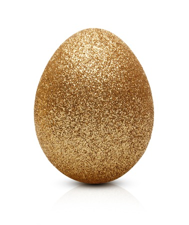 Easter golden egg isolated on white background 免版税图像