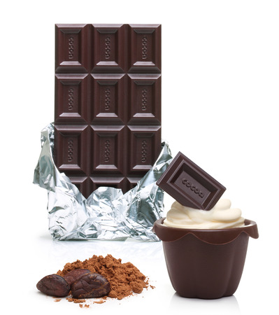 silver bars: Dark chocolate bar in foil, cupcake, cacao beans and powder  isolated on white background