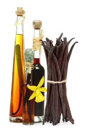 extract: Vanilla extract, pods and orchid flower isolated on white background
