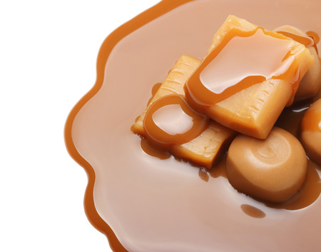 toffee: Caramel toffee and sauce isolated on a white background Stock Photo