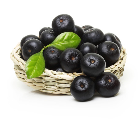 Berries in bowl isolated on white background.