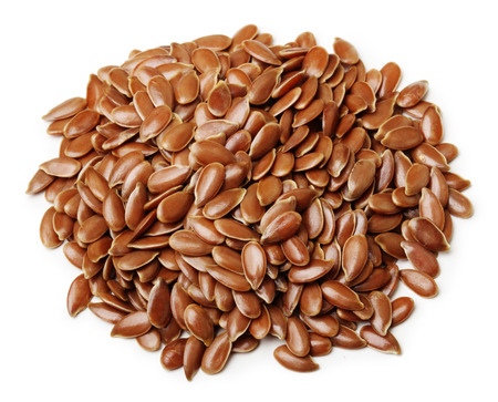 linum usitatissimum: Brown flax seeds isolated on white background Stock Photo