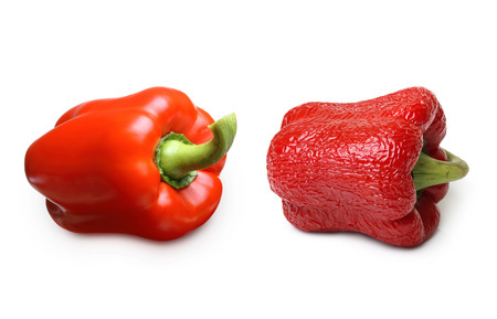 aging: Wrinkled and fresh pepper isolated on white background. Aging concept. Stock Photo
