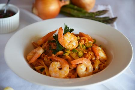 enjoyable: Enjoyable shrimp pasta with tomato sauce Stock Photo