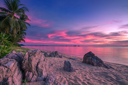 Tropical beach at pink sunset with palm trees in Taling Ngam Beach, Koh Samui island, Thailand.