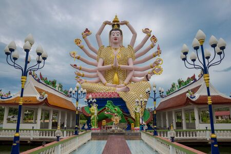 Big Statue of Shiva many hands in Wat Plai Laem Temple on Koh Samui island in Thailand