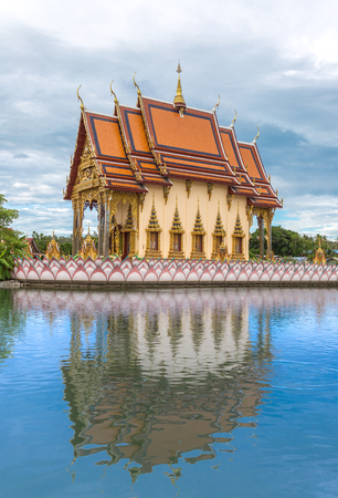 Wat Plai Laem buddhism Temple reflected in the lake in Koh Samui, Thailand