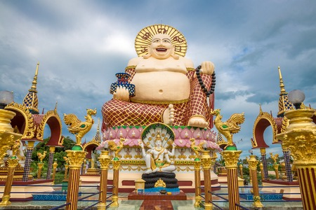 Giant Budai or Pu-Tai or Happy Buddha or Laughing Big Buddha statue at Wat Plai Laem Temple in the Samui island in Thailand 版權商用圖片