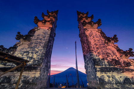 The Gateway to Heaven at Pura Luhur or Lempuyang Temple with view to the Agung volcano in beautiful sunset sky in Bali, Indonesia