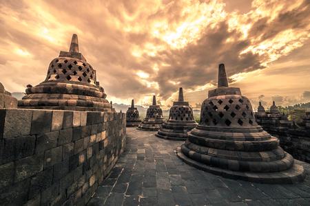 Dramatic sunset Borobudur Temple at sunset Yogyakarta, Java, Indonesia. 版權商用圖片