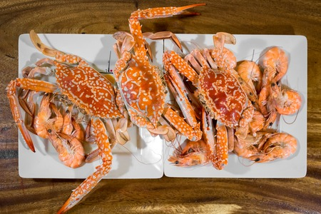 Seafood plates with crabs and shrimps on a wooden table
