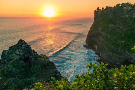 Beautiful Sunset on the background of the sea and rocks at Uluwatu temple, Bali, Indonesia