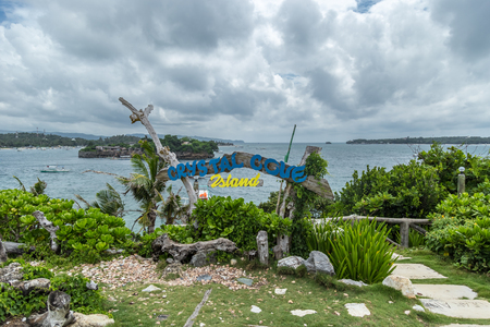 The inscription on a beautiful tropical Crystal Cove island near Boracay island in the Philippines