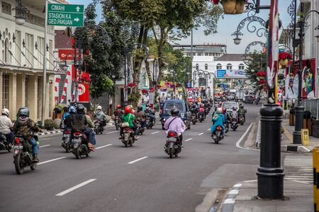Scooters traffic in the center of Semarang, West Java, Indonesia. October, 2018